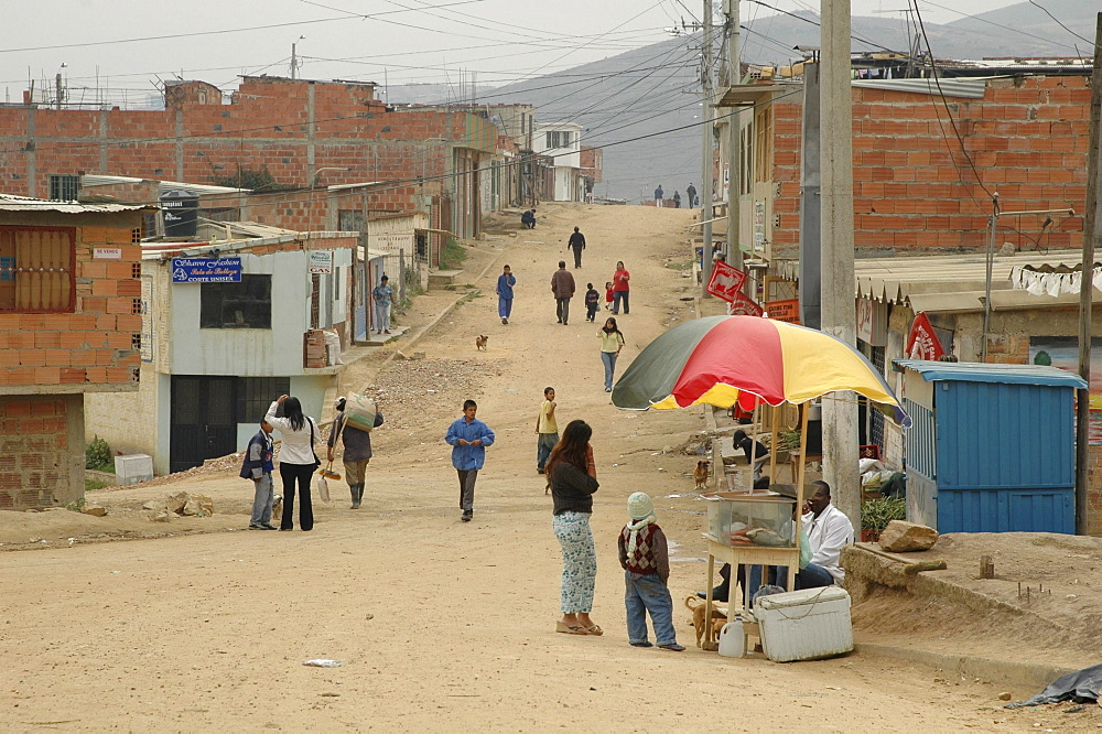 Colombia street scene in the sprawling slum development at altos de cazuca, bogota