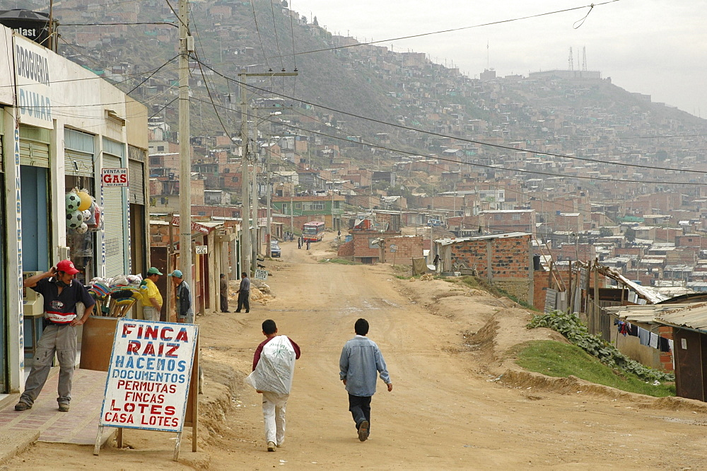 Colombia dirt road and sprawling slum development at altos de cazuca, bogota