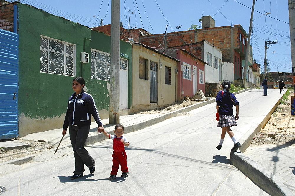 Colombia girls walking home from school in ciudad bolivar, bogota