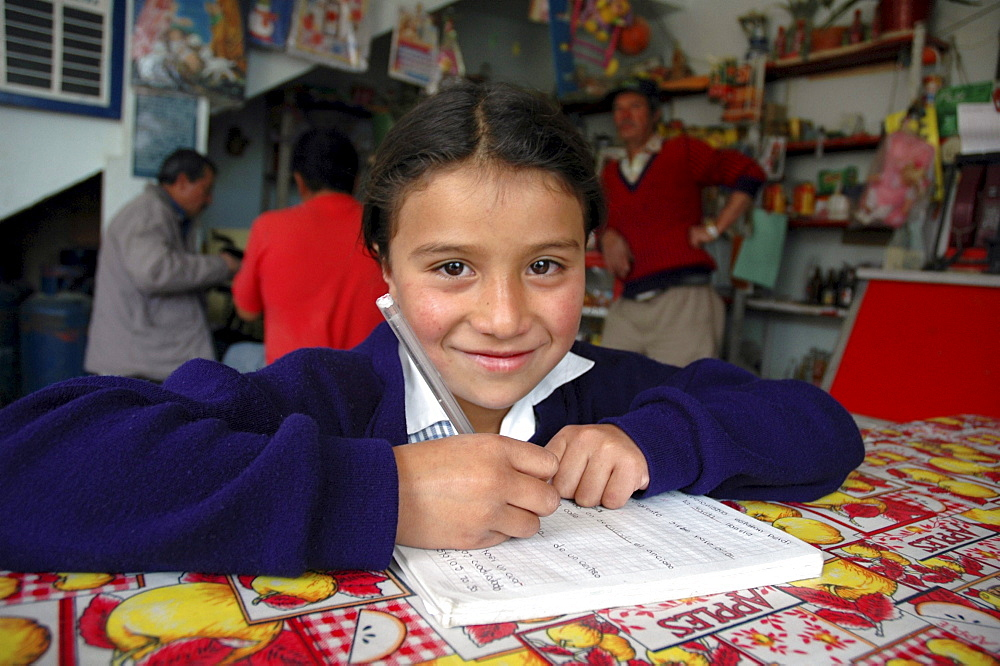 Colombia marly juliet, 7, of the slum of altos de cazuca, bogota, doing her homework