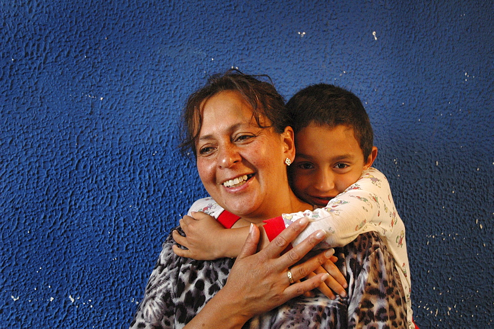 Colombia day in the life series: hugo andres, 7, of ciudad bolivar, bogota, with his mother ageda, 44