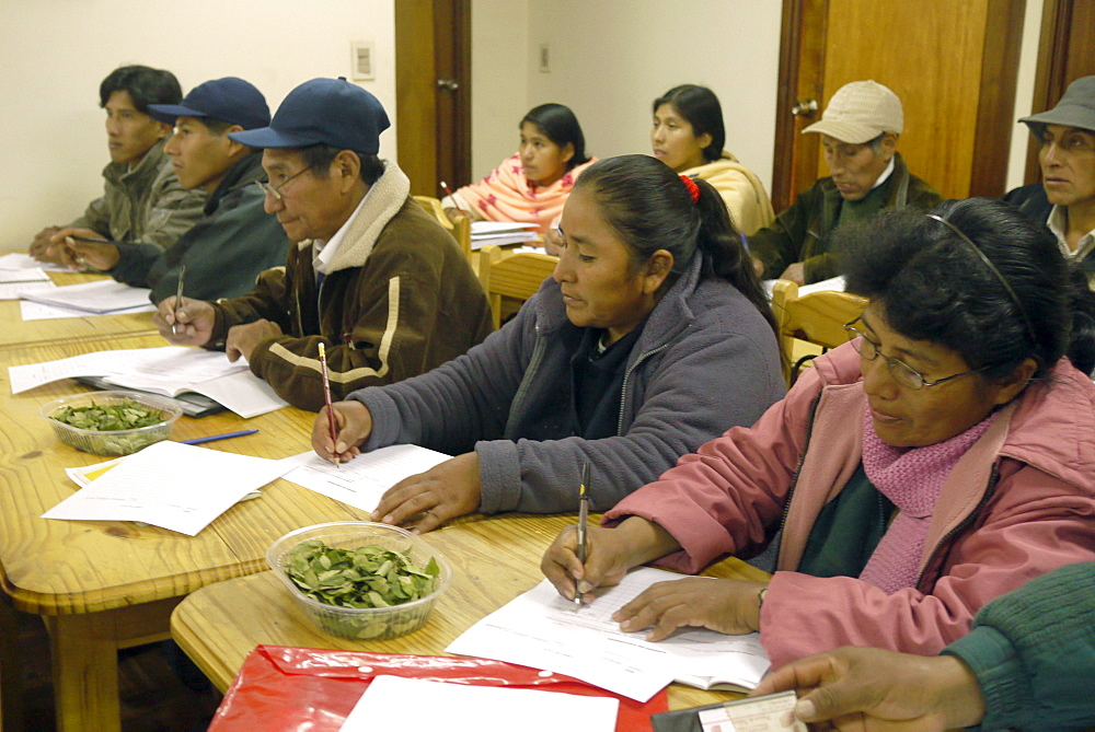BOLIVIA FUNDAWI: training a group at the FUNDAWI office in La Paz. Coca leaves on the table for chewing