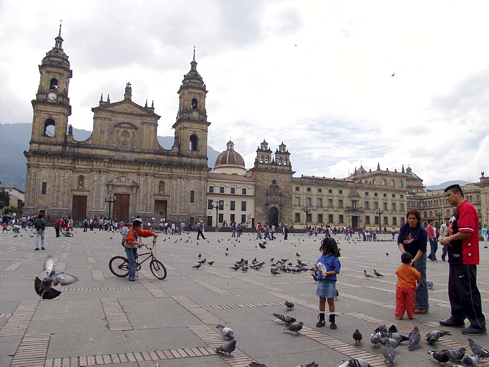 Colombia sunday in la candelaria, bogota, when the streets are closed to motor traffic and opened for cyclists until 2 pm. Santa clara cathedral in the plaza bolivar