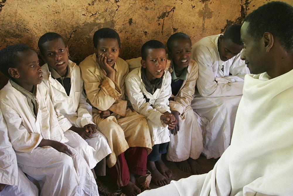 Ethiopia boys chanting geez prayers. Mihur eyesus orthodox monastery, gurage