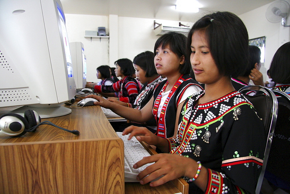 Thailand lisu tribal schoolgirls using computers in their secondary school at chiang dao village, near chiang mai