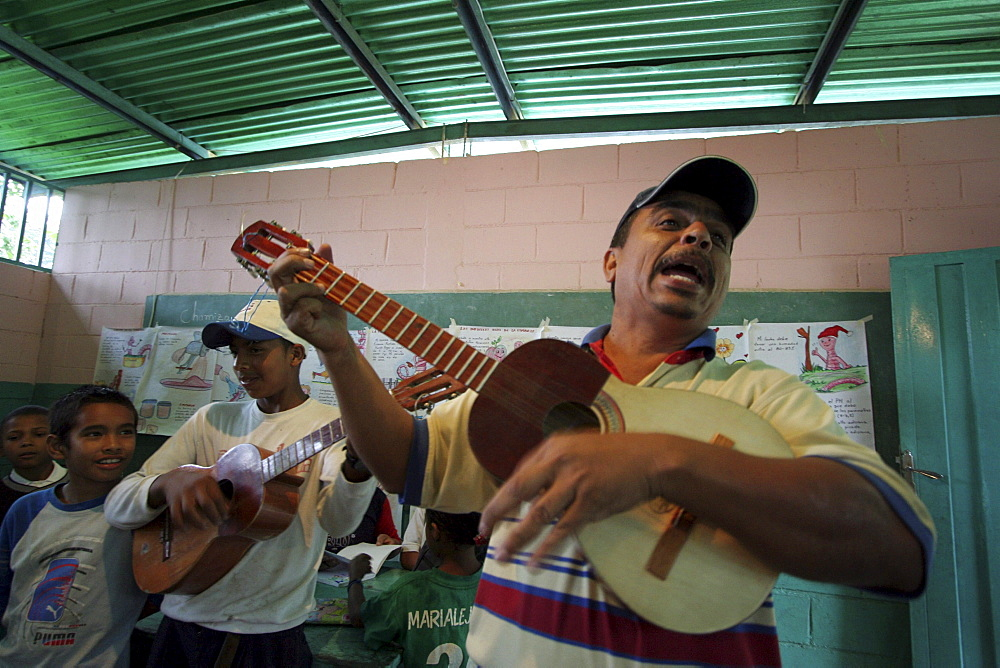 Venezuela teachers and children playing music, chamiza school, lara