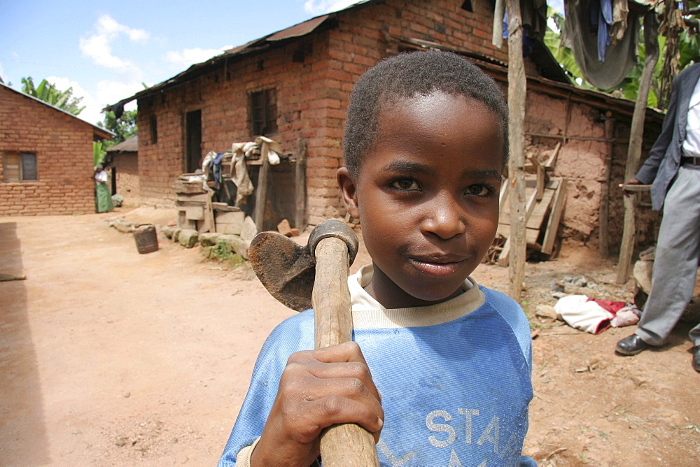 Tanzanian boy carrying a hoe. Kighare, same, in the north-east near kilimanjaro