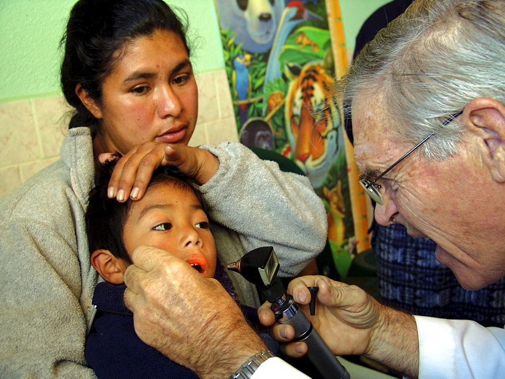Guatemala doctor will van wisse examining a child at the santa clara la laguna clinic