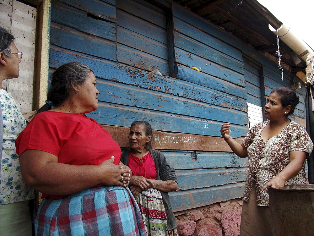 Honduras neighbours visiting in a slum of tegucigalpa