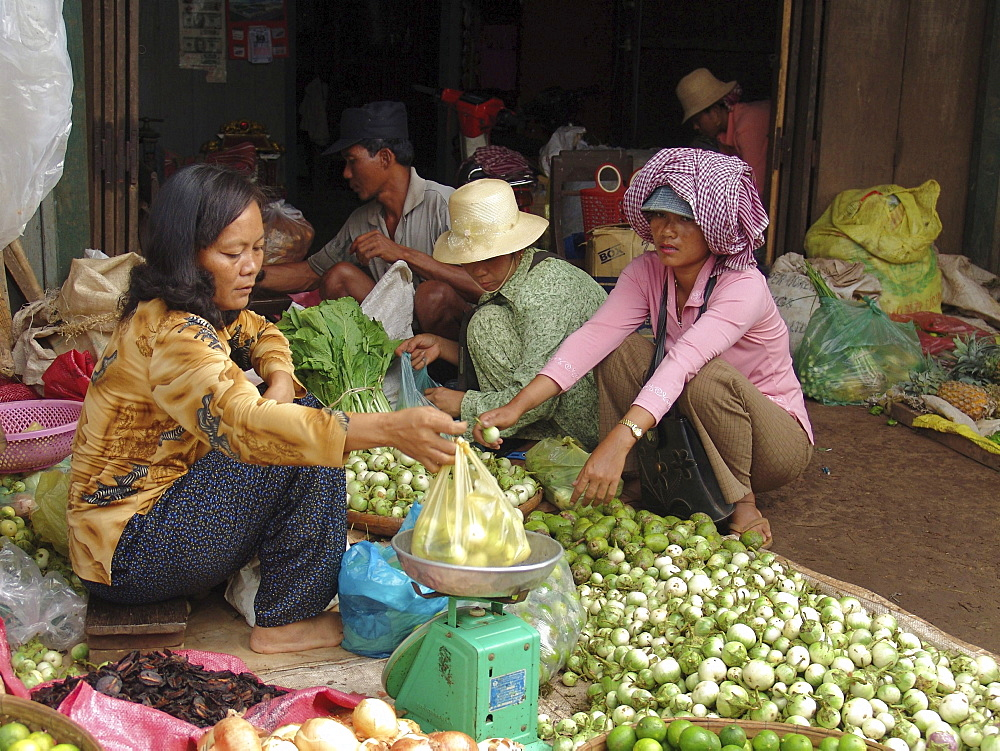 Cambodia woman selling guavas, market, kampong thom town