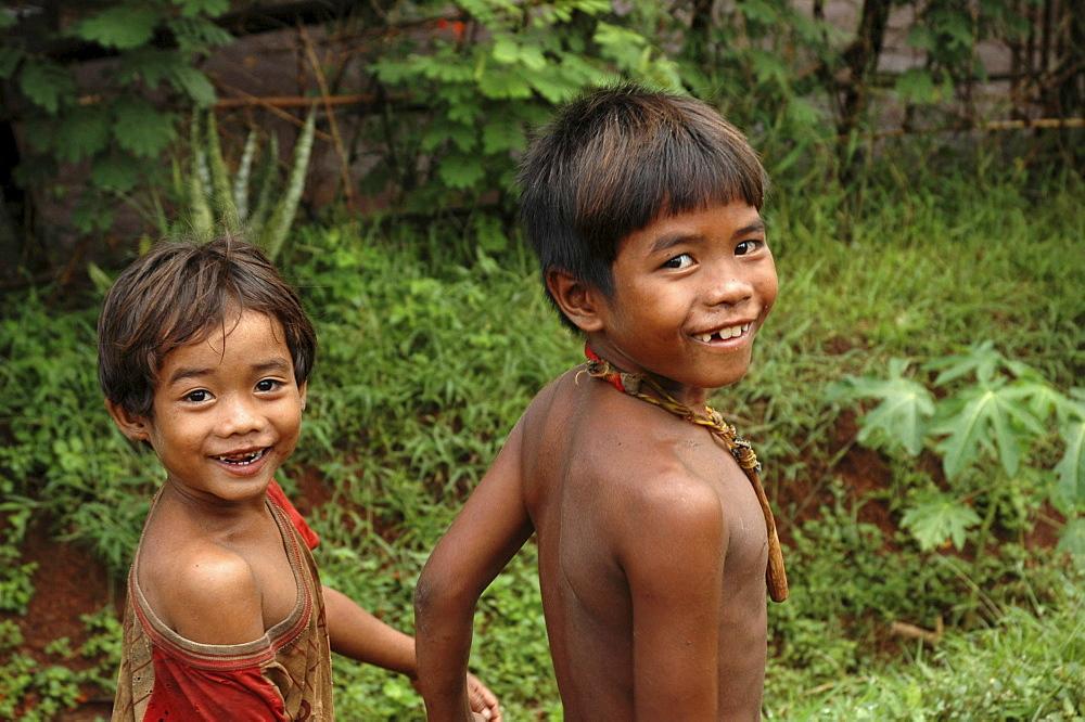 Cambodia boys walking hand-in-hand, kampong cham
