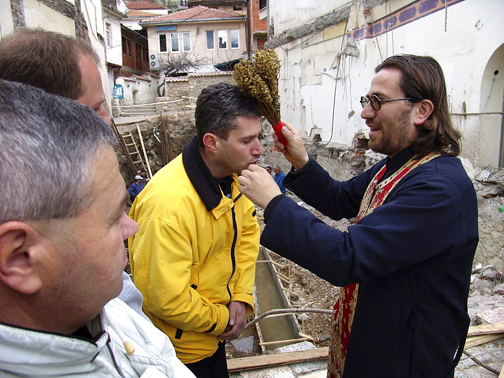 Macedonia (the former yugoslav republic of macedonia, fyrm) orthodox priest giving a blessing in public. The town of ohrid on the shore of lake ohrid