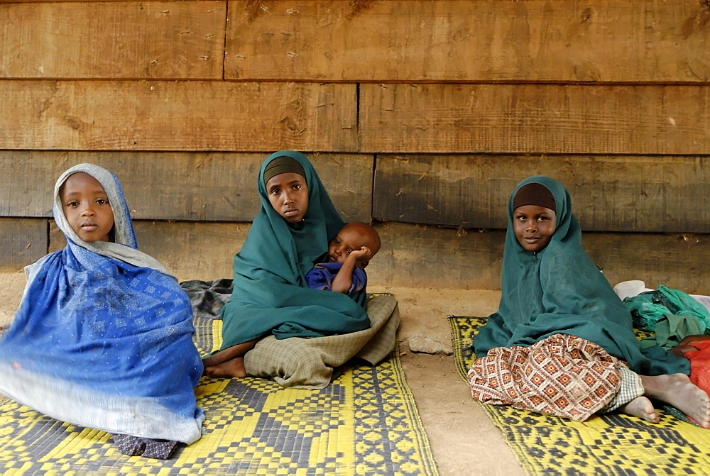 Kenya,dadaab refugees camp, somalian border gtz hospital ,the camps were set up around the town of dadaab beginning in 1991 when civil wars erupted on a grand scale in somalia (16 rival factions were involved). The wars, along with a prolonged drought, forced more than 900,000 somalis to flee to neighboring countries. Approximately 400,000 of them, many of whom were in a serious state of exhaustion and starvation, took refuge in kenya. Since then, a majority have returned to their country. However, some 131,000 somalis remain in kenya, and 110,000 are in dadaab, along with some sudanese, ugandans, and about 3,000 ethiopians women waiting the receive care from gtz ngo at the local hospital
