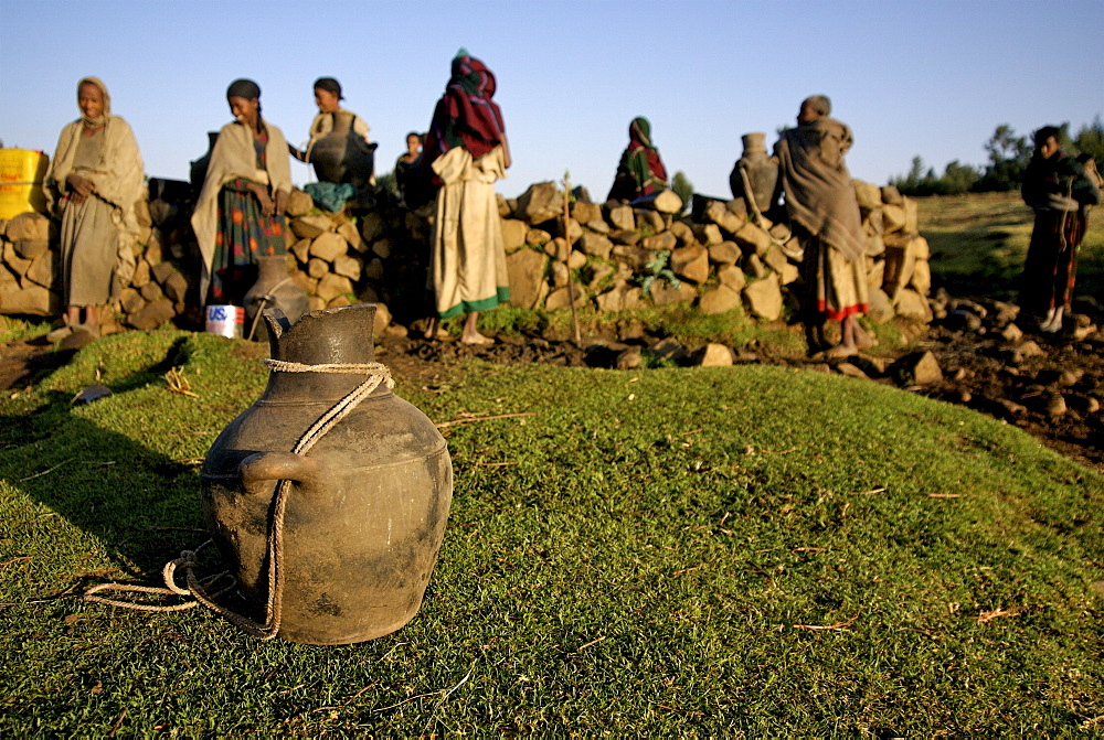 Women fetching water in the hanamerant area ,meket, ethiopia, women fetching water early in the morning. The wells in this area are empty during the dry season,forcing women to walk very long distance to fetch water in the nearest river bed. Ethiopia