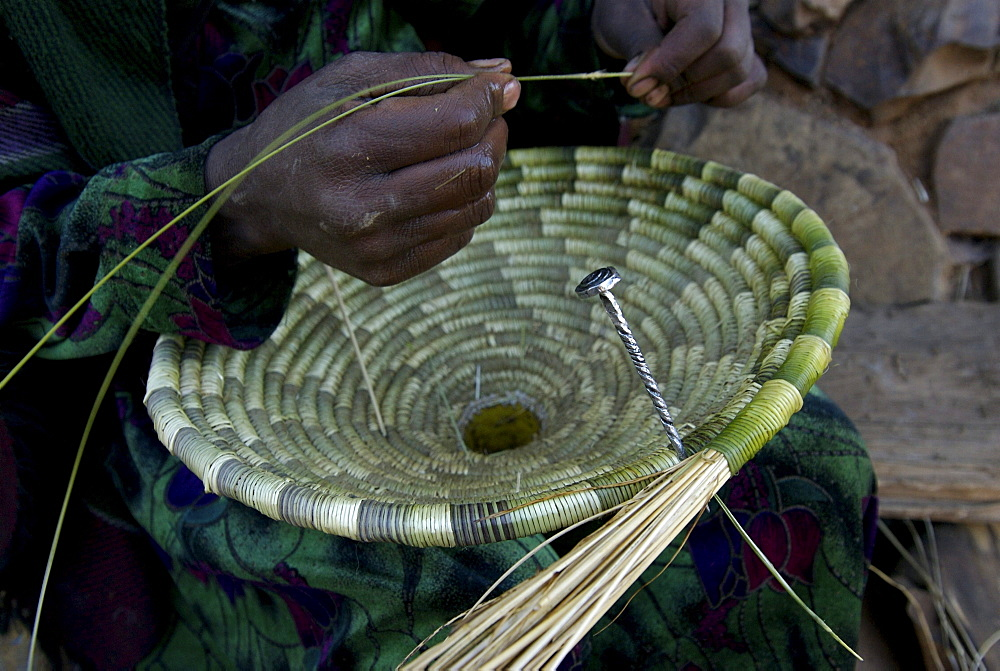 Women working at traditional basket. Most of the furniture in the houses are made out of natural element like sisal,wood or mud. Ethiopia