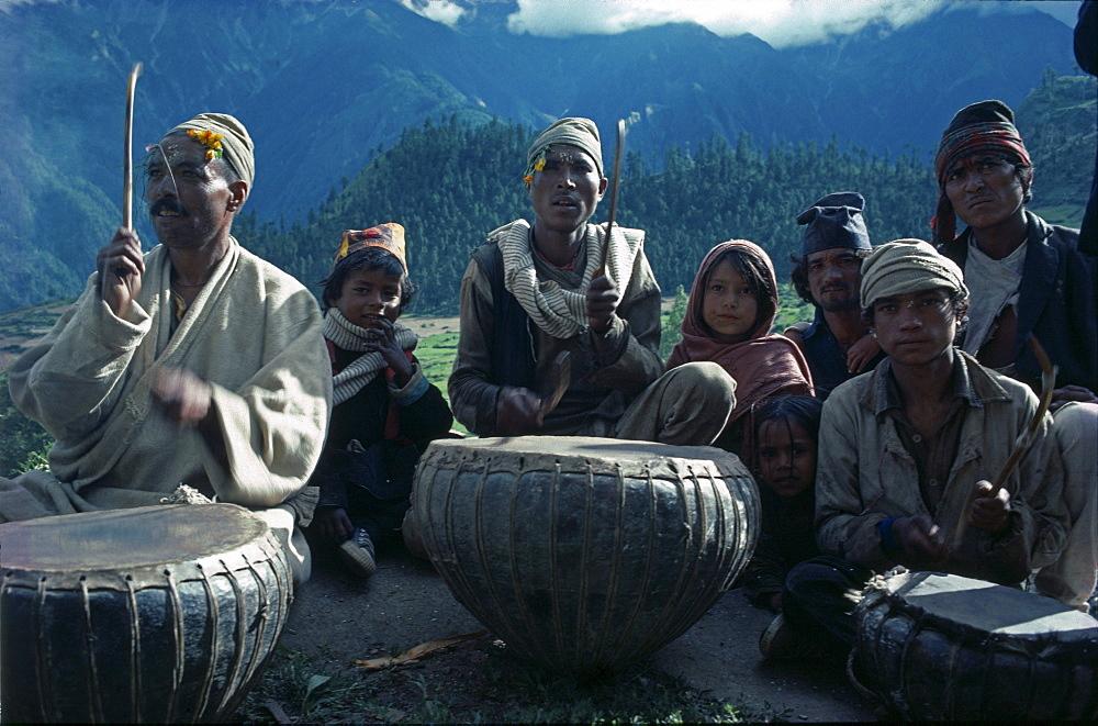 Damai, tailor caste of nepal, playing music on celebration of jania purnima festival humla, north-west nepal