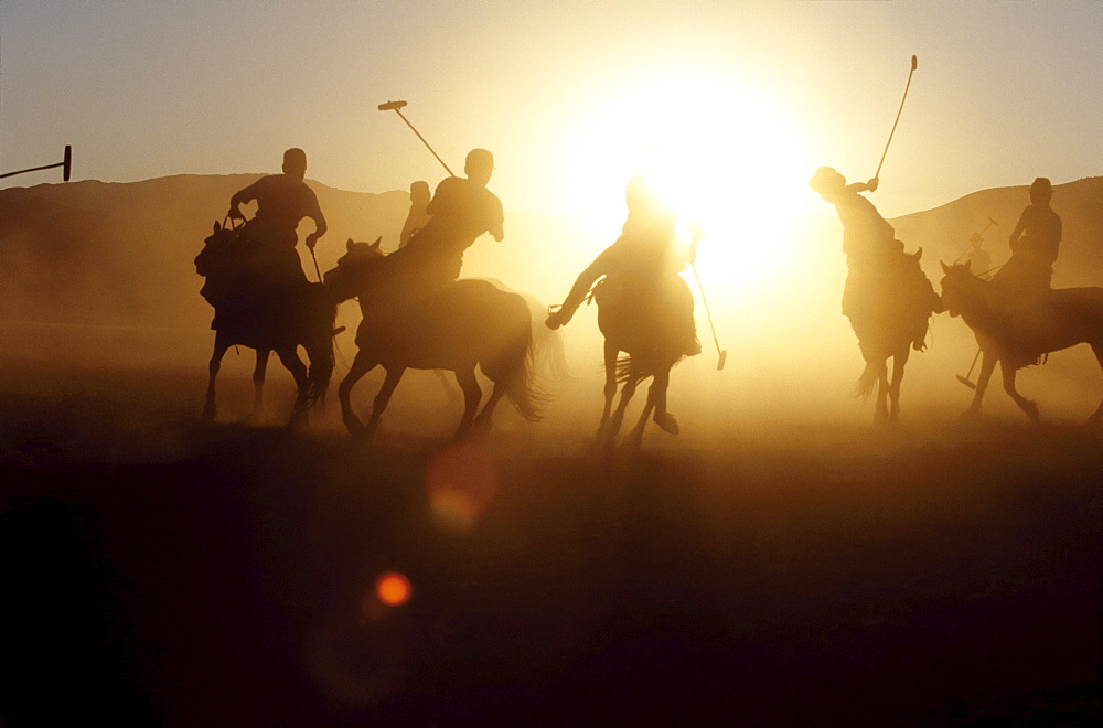 In the 13th century, the golden age of the mongol empire, a sport resembling polo became a training game for the mongolian cavalry throughout high asia. horsemen learned to bend low at speed, like acrobats to finish off fallen enemies with sabres, looting their prey on the ground by scooping up jewels that caught their eye. there are stories, too, of genghis khan knocking about an enemys head as if it were a ball. orkhon valley, central mongolia