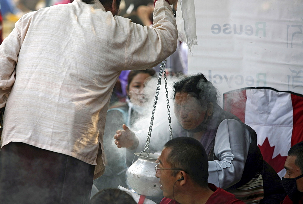 Pilgrims receive puriying essence blessings. Kalachakra initiation in bodhgaya, india