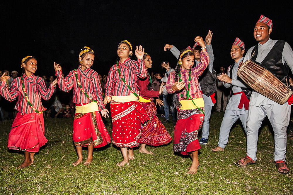 Nepali girls wearing chaubandi cholo (blouse) and fariya (skirt) dancing to the tunes of Nepali folk songs, Assam, India, Asia - 1196-313