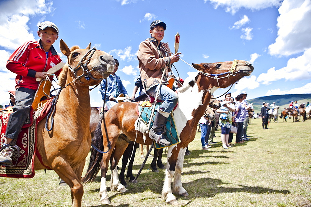 Horses and young horsemen on their mark for this years 20 kms bareback horse race during annual Naadam Festival, Bunkhan, Bulgam, Mongolia, Central Asia, Asia