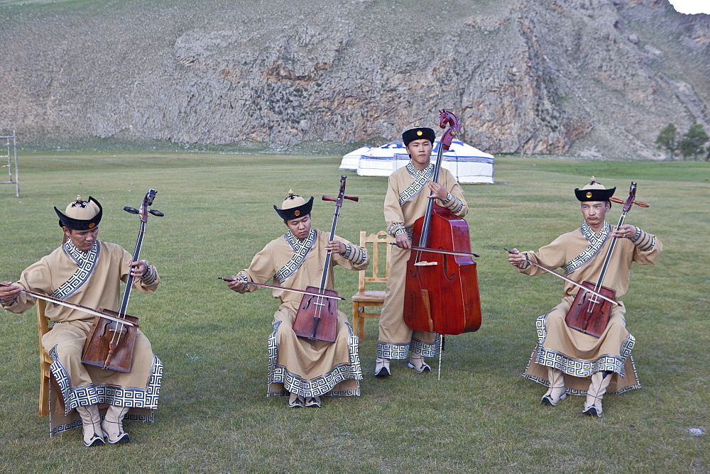 Local band play Mongolia's National instrument, the Morin khuur (horse head fiddle) and perform Khoomi, a throat singing. - 1196-322