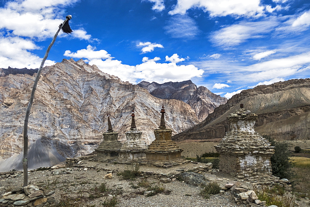 Weathered Buddhist chortens at Neyrak village looking over cliff, Zanskar, India, Himalayas, Asia - 1196-342
