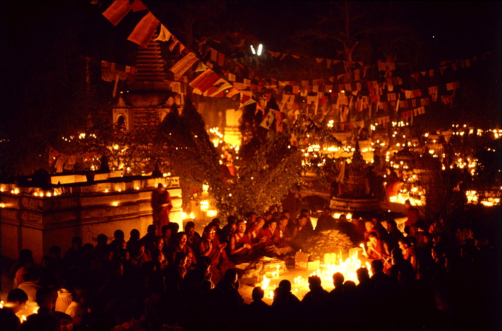 Monks offer butter lamps. Bodgaya, india. Monks offer butter lamps in front of mahabodhi temple marks site of buddha's enlightment twenty-five hundred years. centuries have made pilgrimages across himalayas to sites connected with life of historical buddha. From a tantric perspective, pilgrimage is more than paying homage at sacred sites. Rather, it is that activities performed at these places become a memory of place itself. By attuning oneself through ritual meditation to this timeless presence, similar experiences be evoked