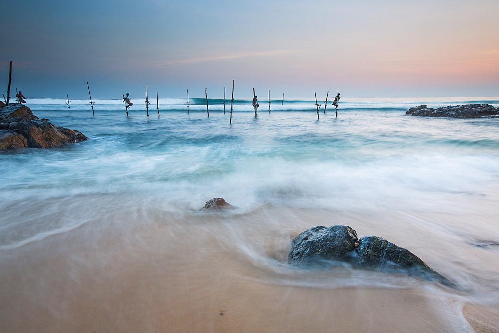 Stilt fishermen, Mirissa, Sri Lanka, Asia
