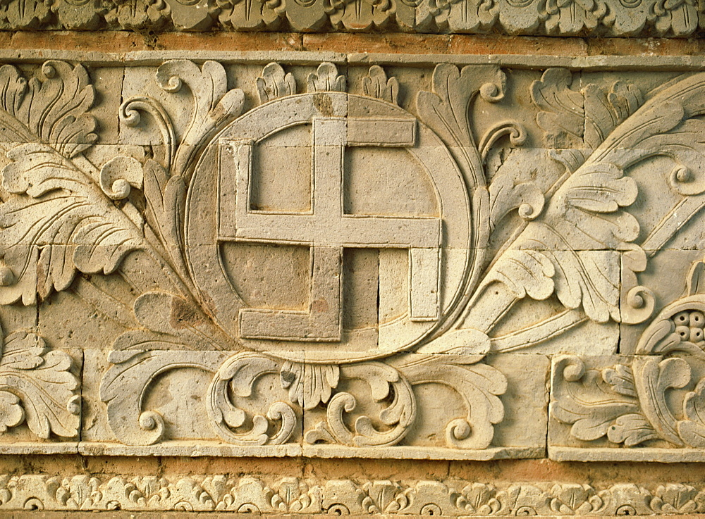 Relief of swastika, an old Hindu symbol, temple of Goa Lawah, east of Klungkung, Bali, Indonesia, Southeast Asia, Asia - 120-2405