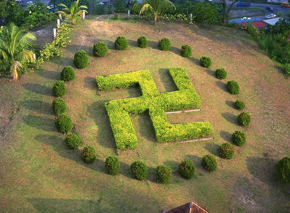 Symbol similar to swastika in garden of Buddhist temple Puu Jih Shih, Sandakan, Sabah, Malaysia, Southeast Asia, Asia - 120-3285