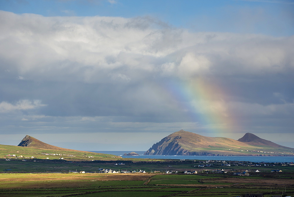 Rainbow over hills and dwellings, looking towards Clogher and Rosroe, Dingle Peninsula, County Kerry, Munster, Republic of Ireland, Europe