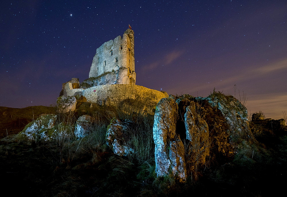 View of rocks and Mirow Castle ruins illuminated at night, Polish Jura, Poland, Europe - 1200-39