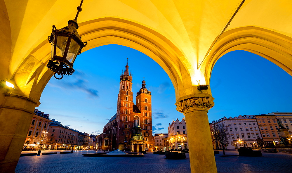 St. Mary's Church (St. Marys Basilica) and main square illuminated at dawn, UNESCO World Heritage Site, Krakow, Poland, Europe