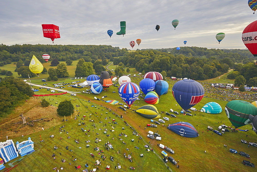 Hot-air balloons taking off from the festival site of the Bristol International Balloon Fiesta, held annually in August, Bristol, England, United Kingdom, Europe - 1202-180