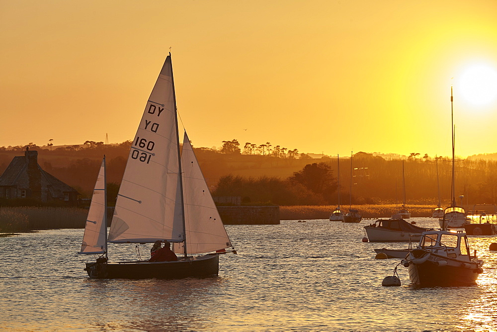 A sunset view of sailing on the River Exe at Topsham, near Exeter, Devon, England, United Kingdom, Europe