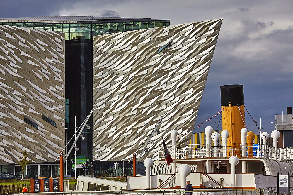 A view of the Titanic Museum, with the SS Nomadic, the only surviving White Star Line ship, in the Titanic Quarter, Belfast, Ulster, Northern Ireland, United Kingdom, Europe