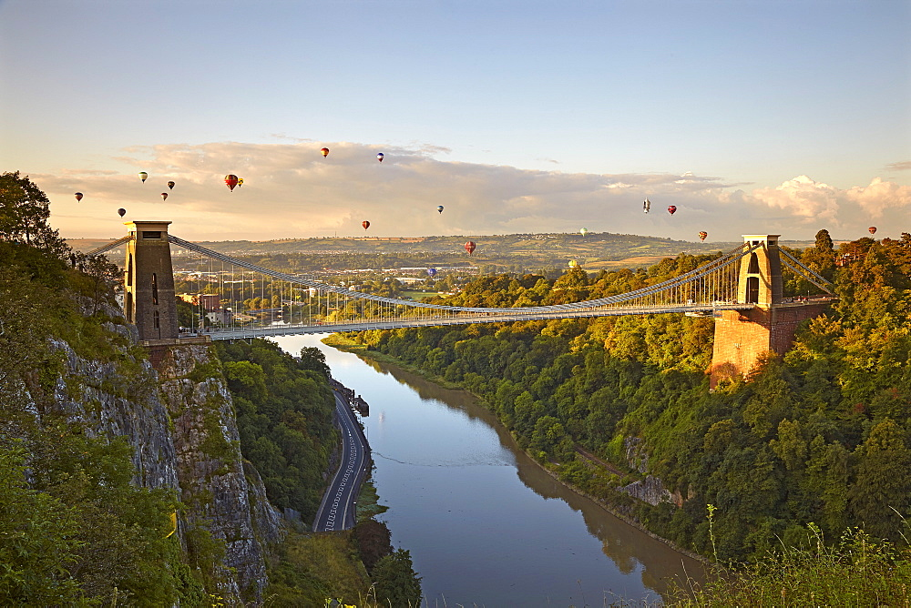 Clifton Suspension Bridge with hot air balloons in the Bristol Balloon Fiesta in August, Clifton, Bristol, England, United Kingdom, Europe
