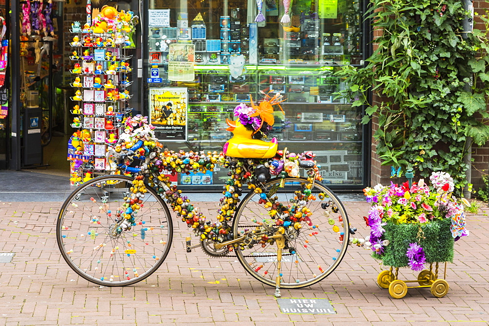 A bicycle outside a shop in Amsterdam, Netherlands - 1207-147