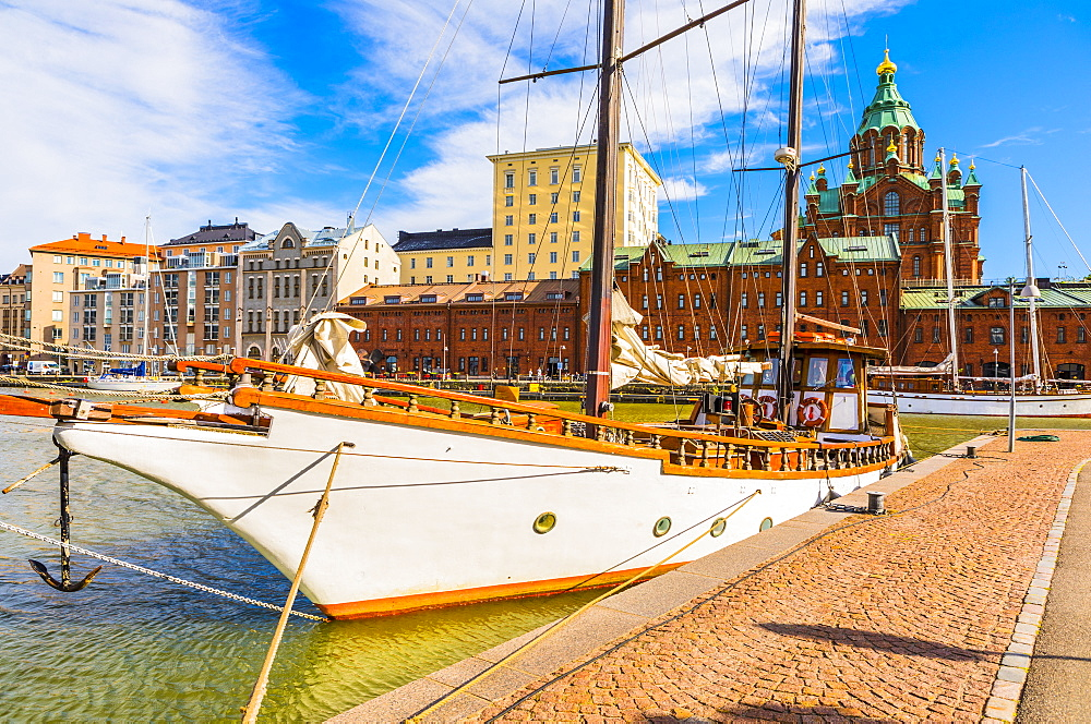 Boats docked at the harbor in Helsinki with Uspenski cathedral in the background, Uusimaa, Finland, Scandinavia, Europe