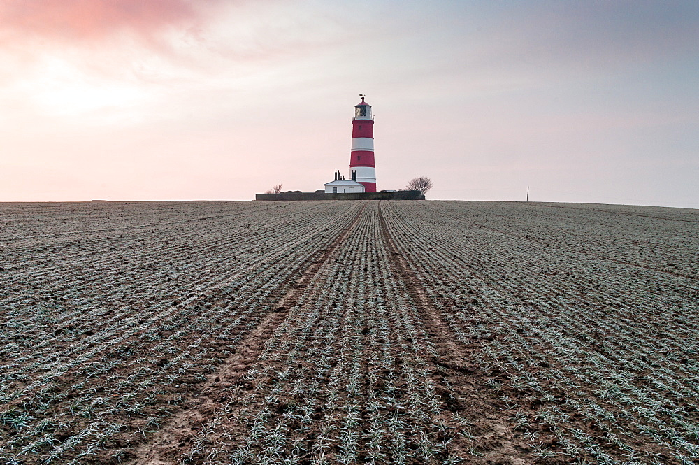 Sunrise at Happisburgh Lighthouse on a frosty morning, Happisburgh, Norfolk, England, United Kingdom, Europe