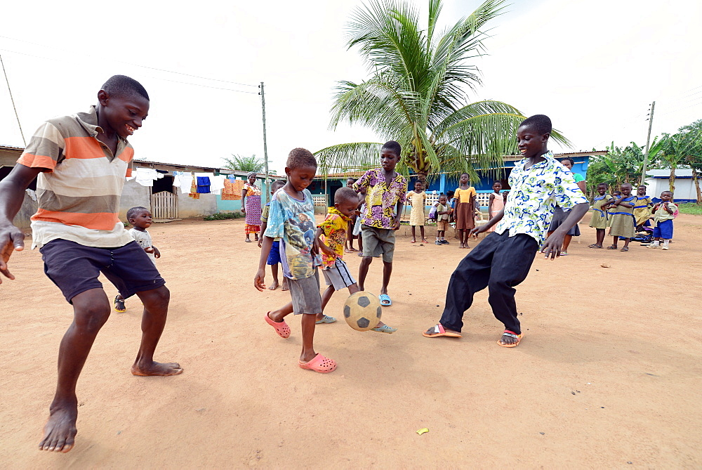 Boys playing football, Adiembra, Ghana, West Africa, Africa