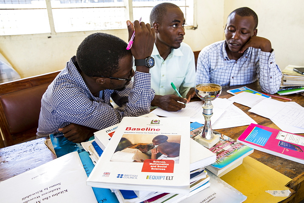 Teachers in discussions during a training session in the school to improve teaching methodologies in classrooms, Angaza school, Lindi, Tanzania, East Africa, Africa