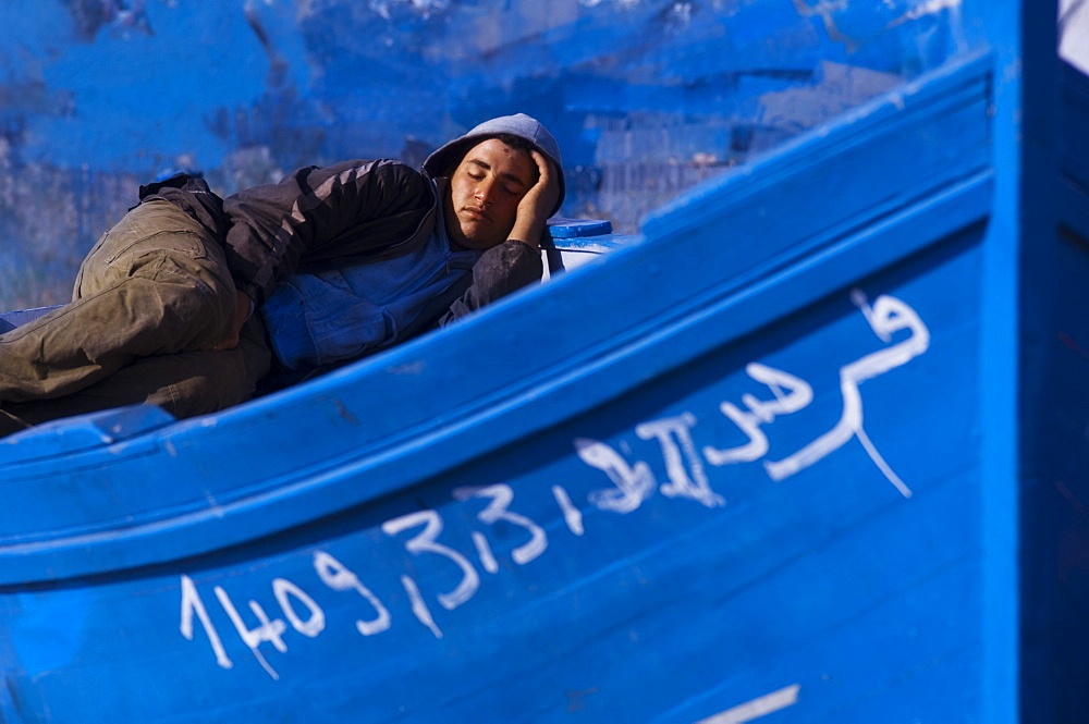 Man sleeping on fishing boat in the fishmarket, Tangier, Morocco, North Africa, Africa