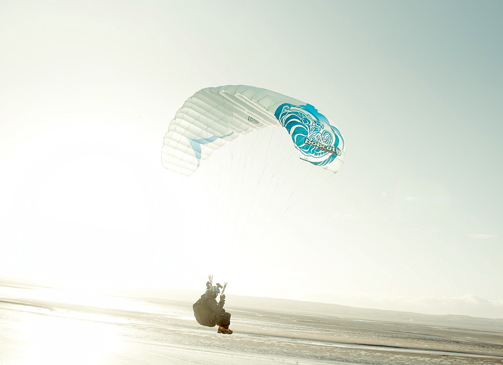 Paragliders soar over the Dee estuary, Wirral, Cheshire, England, United Kingdom, Europe
