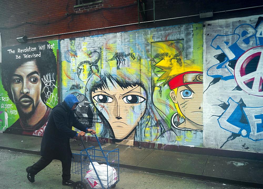 Man and grafitti, New York, United States of America, North America