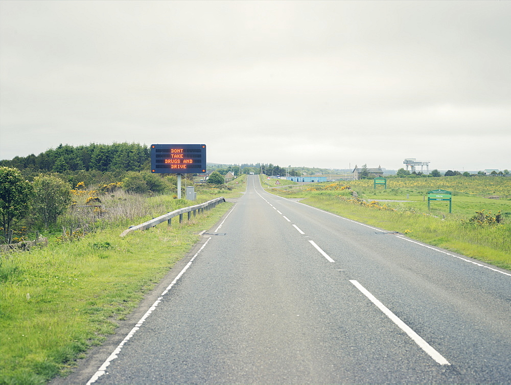 Don't take drugs and drive sign in the remote Highlands of Scotland, United Kingdom, Europe