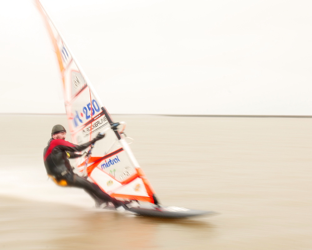 Windsurfer travelling at speed at West Kirby Marine Lake, Wirral, United Kingdom, Europe
