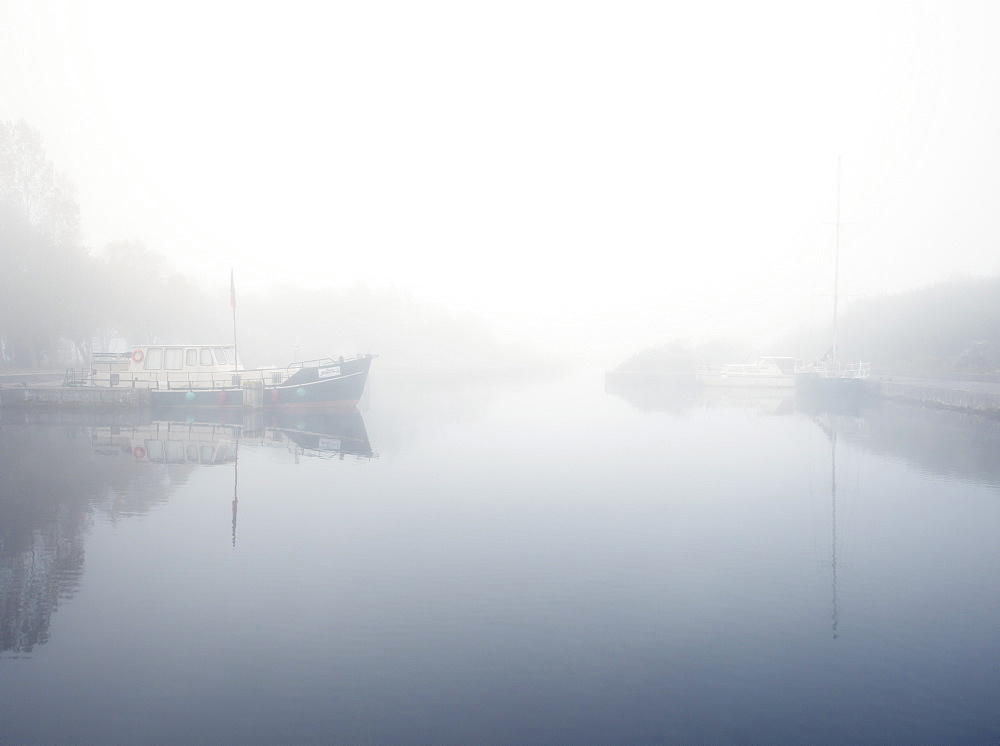 boats in the mist on the river Shannon at Lough Derg, Portumna, Co Galway, Republic of Ireland, Europe