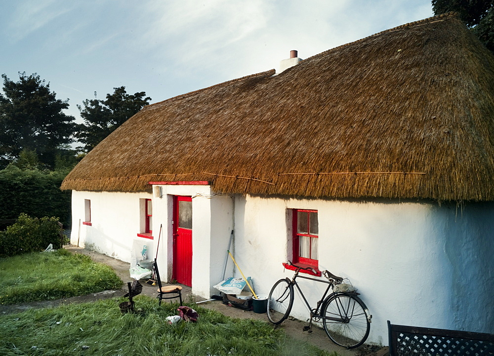 Thatched house and bicycle, Co Kildare, Republic of Ireland, Europe
