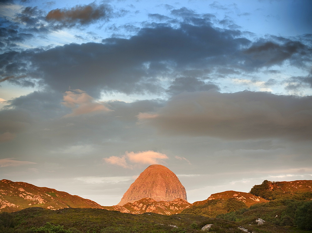 The distinct shape of Suilvan mountain in Assynt, Sutherland in the Highlands of Scotland, United Kingdom, Europe